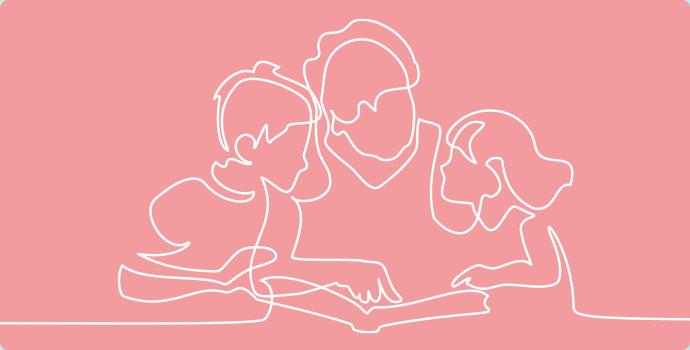 子供に本を読んであげる保育士